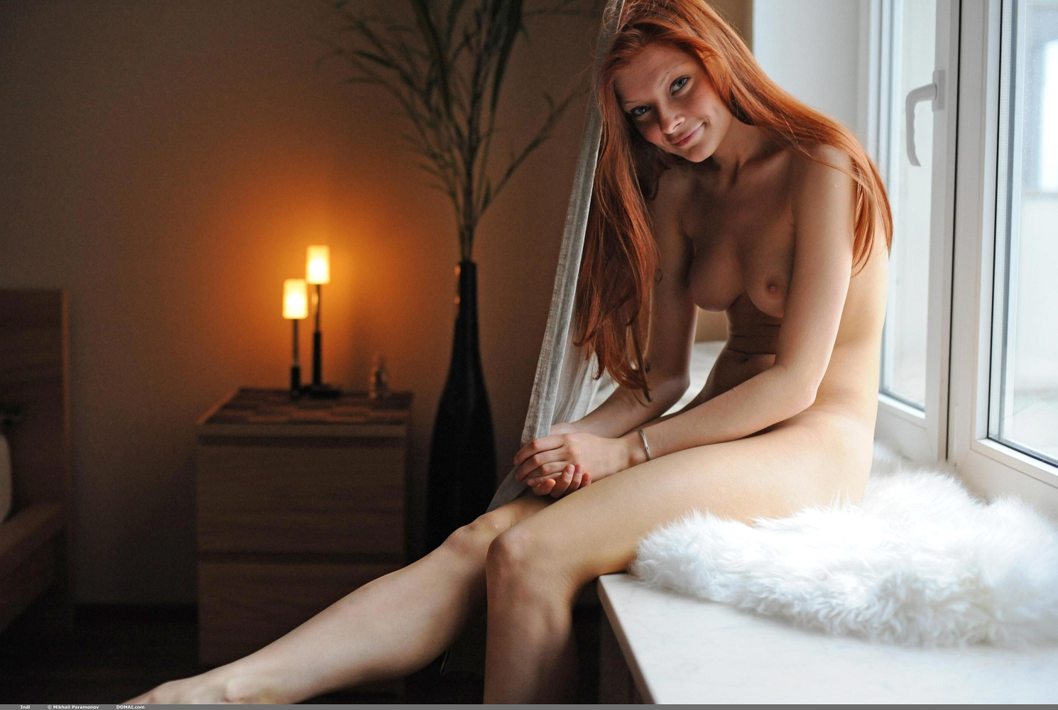 Erotikom.com and DOMAI Simple Nudes present the Redhead Tenderness of Indi and her astounding, angelical Beauty photographed by Mikhail Paramonov. Get the original full size HD quality photo collection Only at DOMAI!