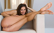 Erotikom.com and FEMJOY Pure Nudes present Loretta enjoys her nakedness, all natural body beauty, alone by her sofa. Exclusively at FEMJOY.com in a 16 photos gallery by The Master, Stefan Soell