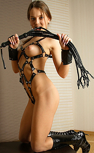 Erotikom.com and MPLstudios.com present Malisha has an Angel DollFace, but here we see her kinky, harder side, getting erotically bondaged in leather boots and outfit. Just be careful with her whip, so delicious! MPLstudios erotica fantasy in 23 pics